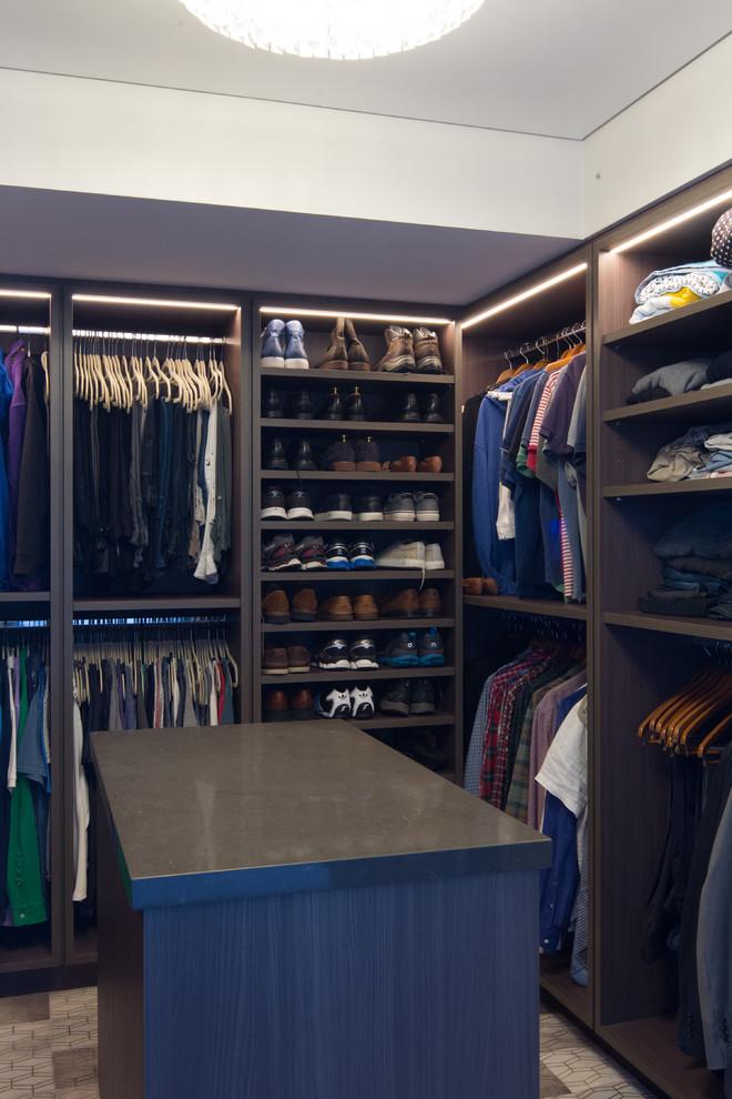 Mid-sized contemporary gender-neutral walk-in wardrobe in Sydney with open cabinets, medium wood cabinets, dark hardwood floors and beige floor.