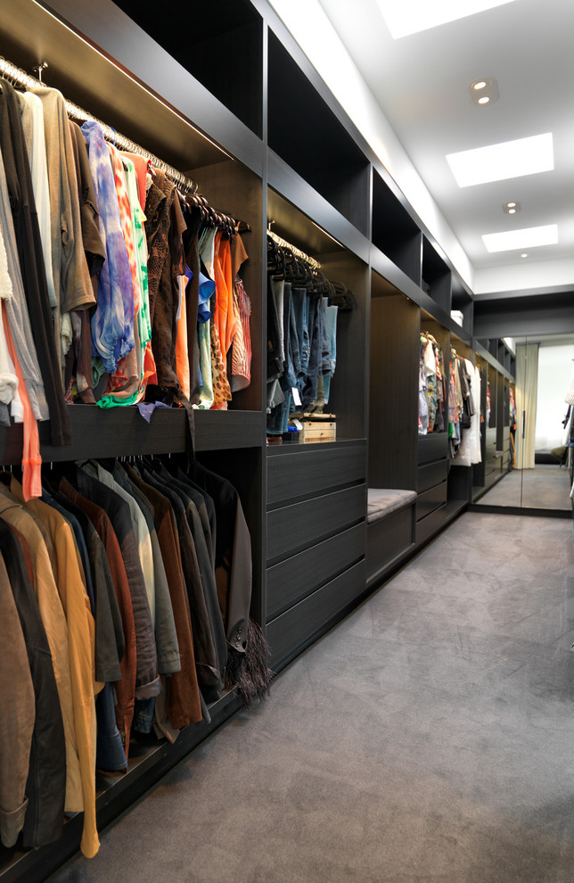 Walk-in closet - large contemporary men's carpeted walk-in closet idea in Melbourne with open cabinets and black cabinets