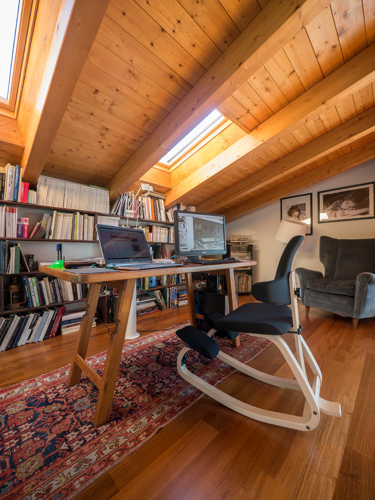Inspiration for a farmhouse freestanding desk medium tone wood floor home office remodel in Milan with white walls