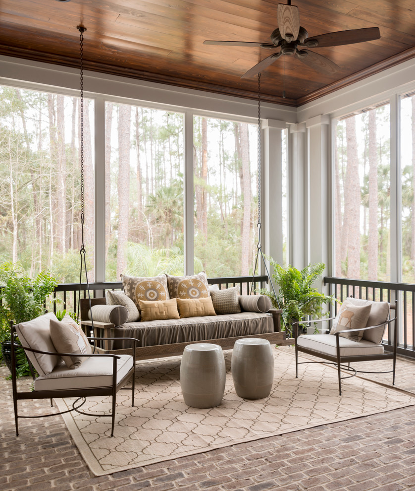 Large transitional brick floor and gray floor sunroom photo in Charleston with a standard ceiling and no fireplace