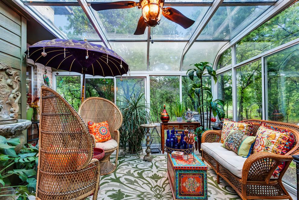 Example of an island style sunroom design in Dallas