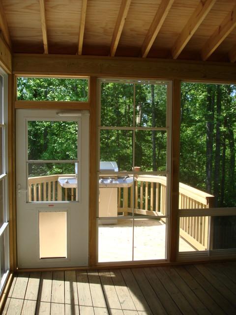 3 Season Room With Eze Breeze Windows Leading To Wood Deck
