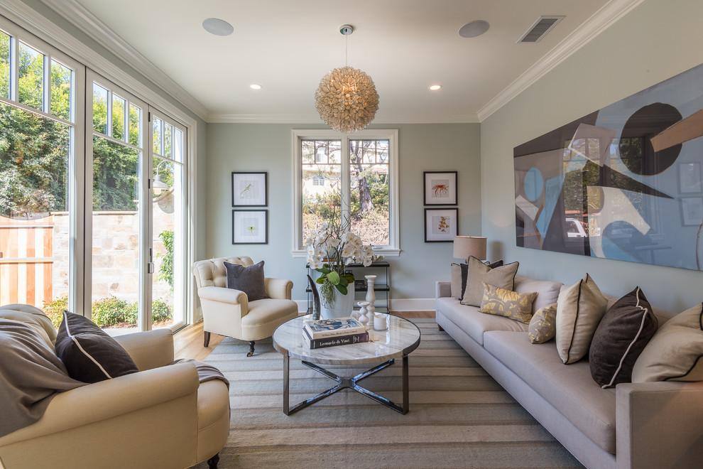 Sunroom - coastal medium tone wood floor and brown floor sunroom idea in Los Angeles