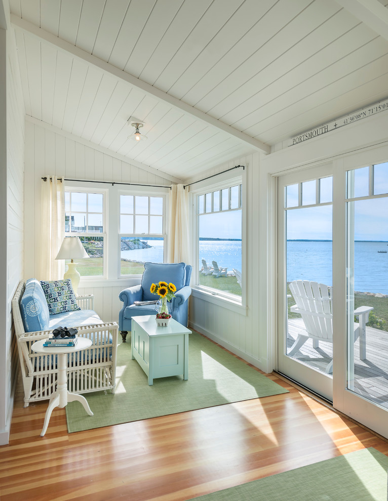 Beach style medium tone wood floor and beige floor sunroom photo in Providence with a standard ceiling