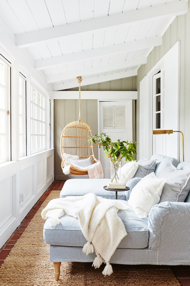Example of a beach style brick floor sunroom design in San Francisco with a standard ceiling