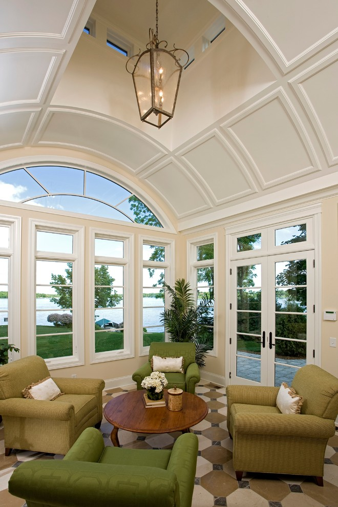 Example of a large classic vinyl floor and multicolored floor sunroom design in Minneapolis with a skylight and no fireplace