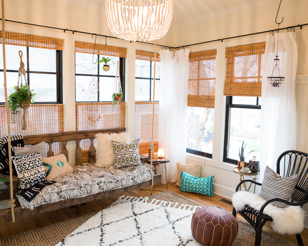Danish medium tone wood floor and brown floor sunroom photo in Kansas City with a standard ceiling
