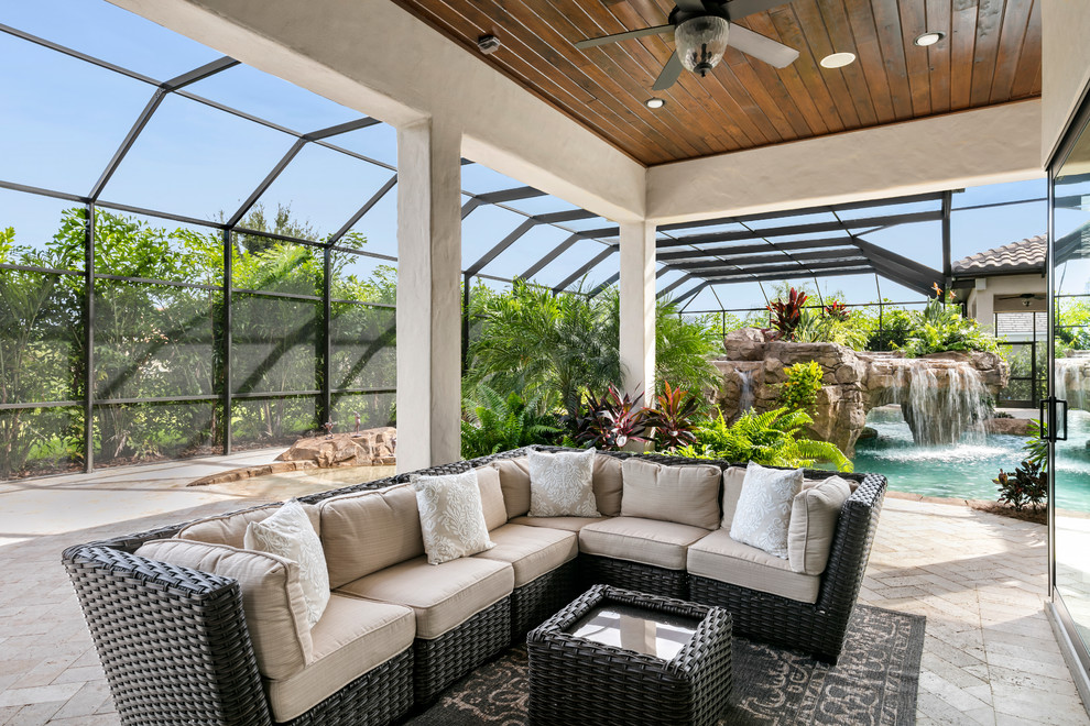 Example of a huge tuscan sunroom design in Orlando