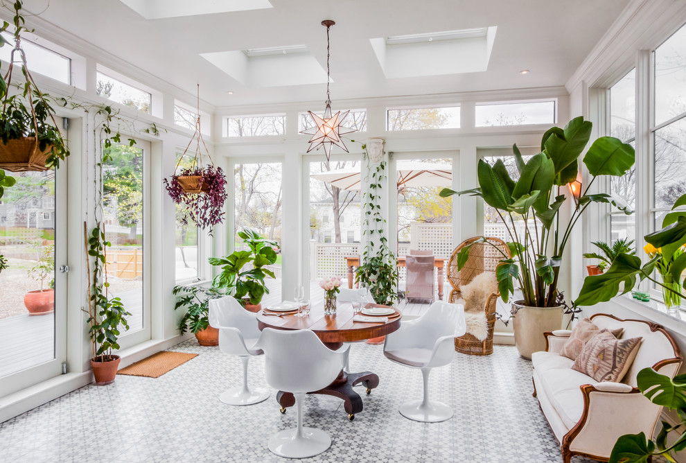 Large transitional ceramic tile and multicolored floor sunroom photo in Boston with a skylight