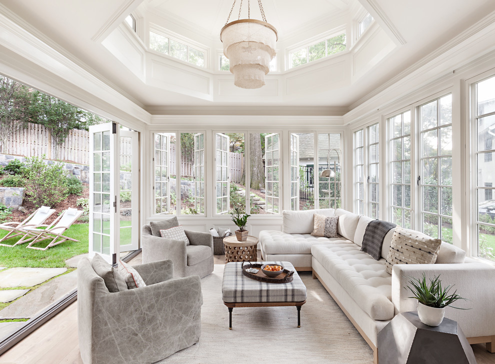 Large elegant light wood floor and brown floor sunroom photo in New York with no fireplace and a standard ceiling