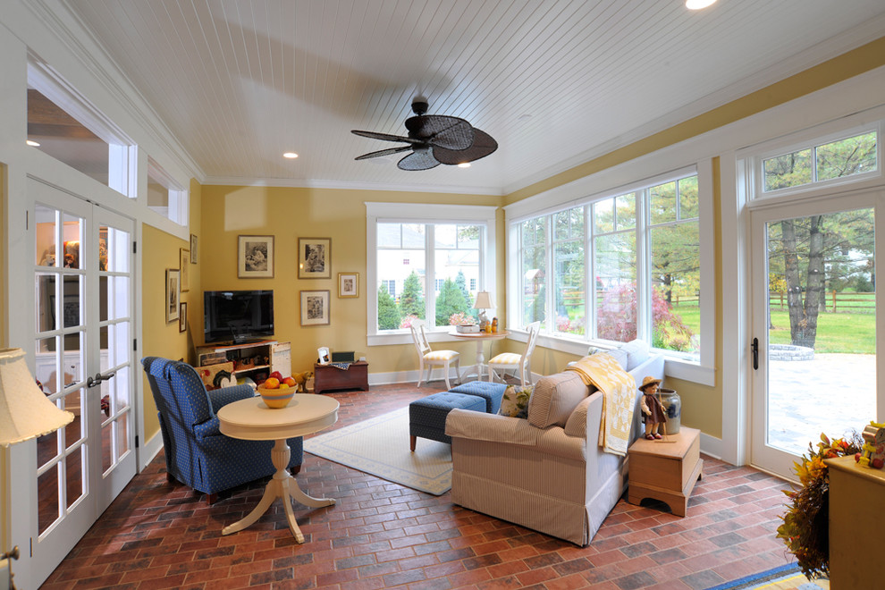 Inspiration for a timeless brick floor and red floor sunroom remodel in Cincinnati with a standard ceiling