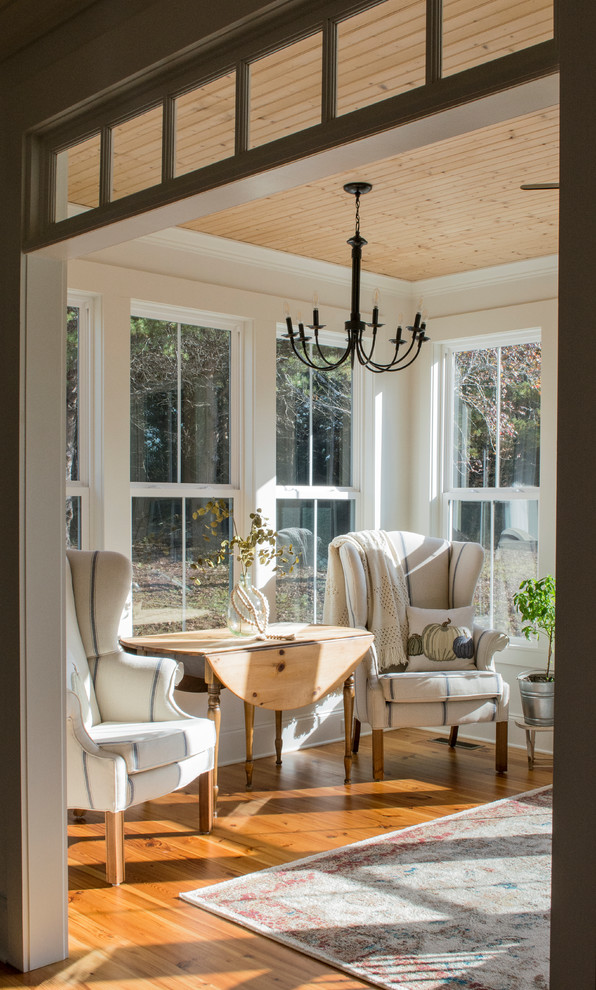Mid-sized cottage medium tone wood floor and brown floor sunroom photo in Other with a standard ceiling