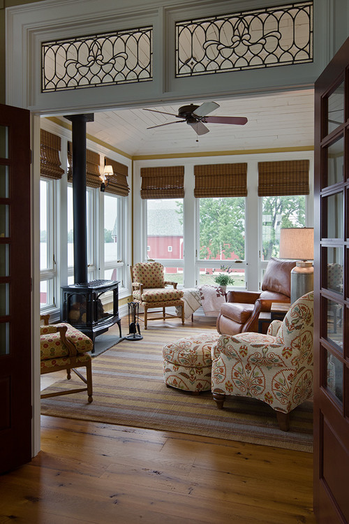 11 pretty sunrooms to love town country living for Kitchen with sunroom attached
