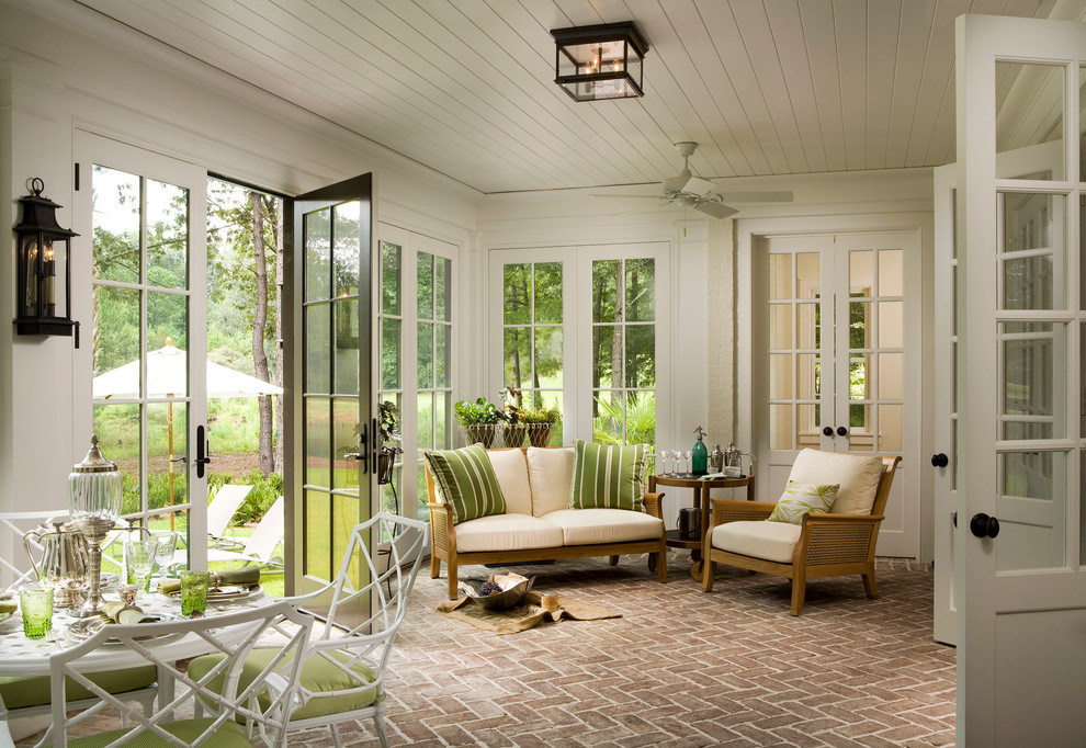 Sunroom - farmhouse red floor sunroom idea in Atlanta