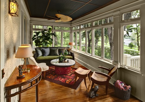 10 impressive sunrooms that we need to sip lemonade in for Enclosed back porch ideas
