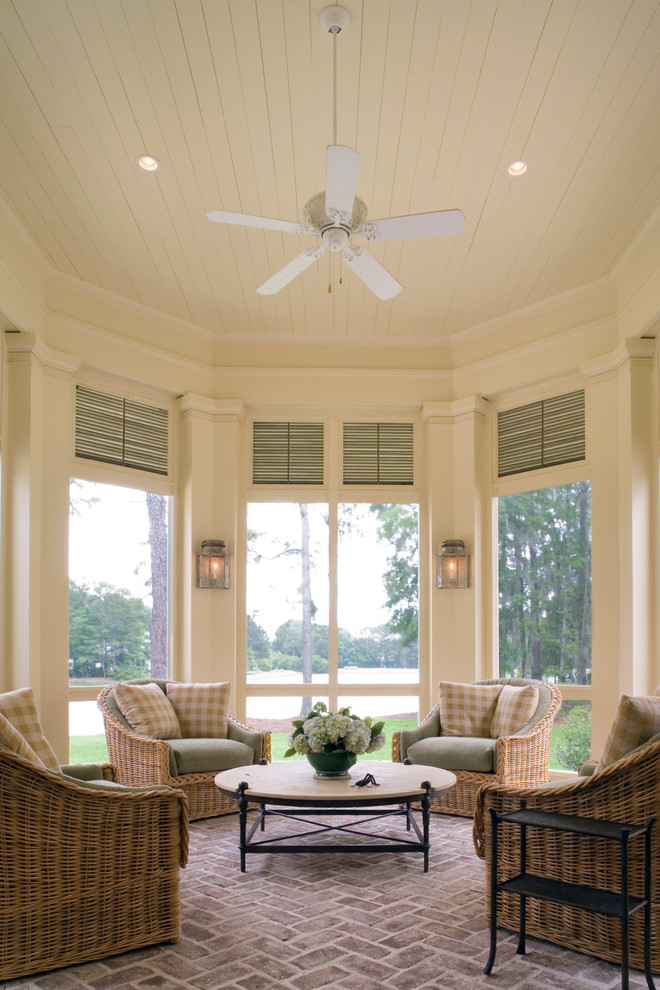 Example of a classic brick floor sunroom design in Atlanta with a standard ceiling