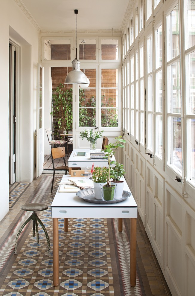 Sunroom - mid-sized transitional ceramic tile sunroom idea in Madrid with no fireplace and a standard ceiling