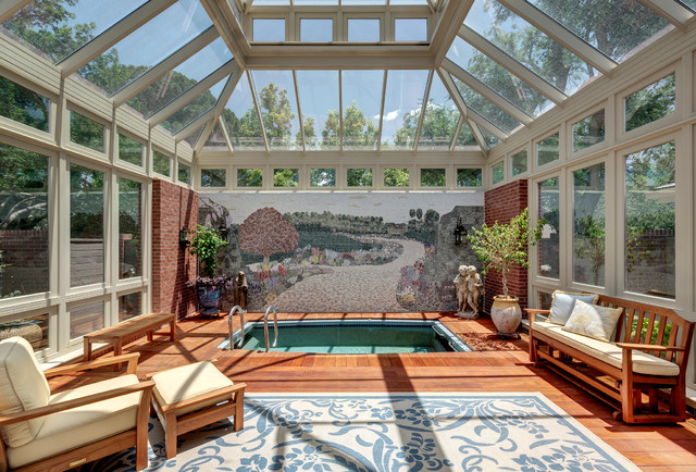Pool Im Wintergarten indoor patio and pool traditional sunroom by