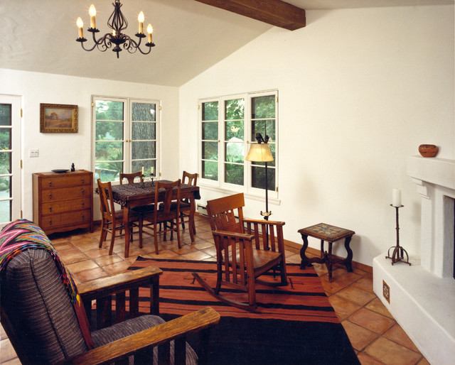 Example of a mid-sized tuscan terra-cotta floor sunroom design in Los Angeles with a corner fireplace and a plaster fireplace