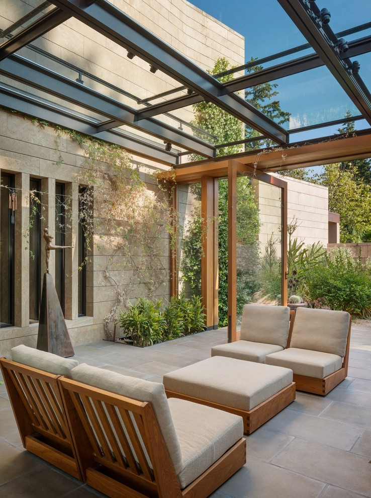 Sunroom - mid-sized contemporary concrete floor sunroom idea in Seattle with a glass ceiling