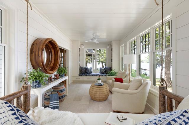 Esempio di una veranda stile marino con nessun camino, soffitto classico e pavimento beige