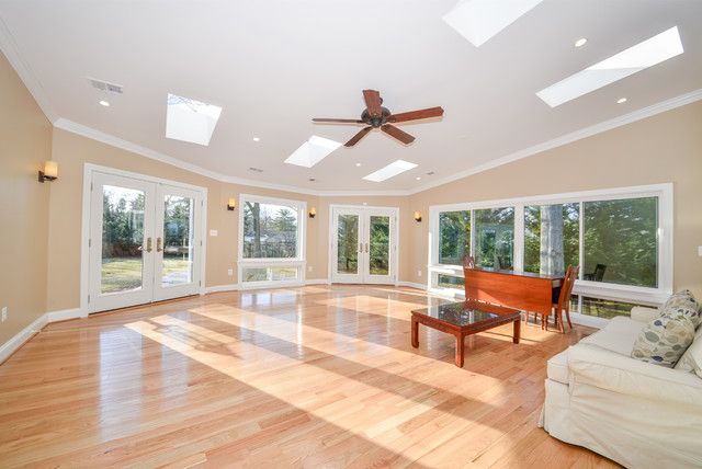 Large windows and double french doors flood room with for Large windows for sunroom