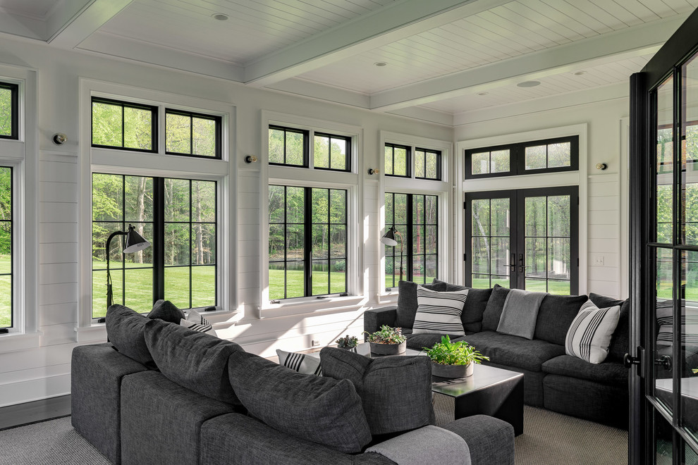 Inspiration for a large farmhouse gray floor and dark wood floor sunroom remodel in New York with a standard ceiling