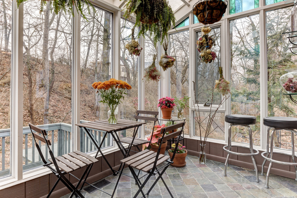 Eclectic slate floor sunroom photo in Columbus with a glass ceiling