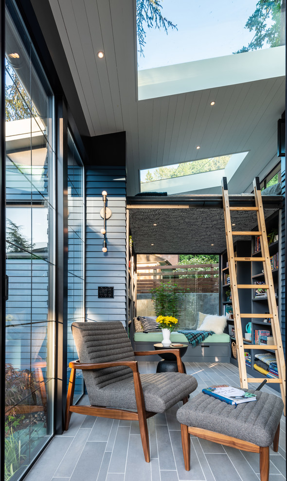 Example of a trendy gray floor sunroom design in Seattle with a skylight