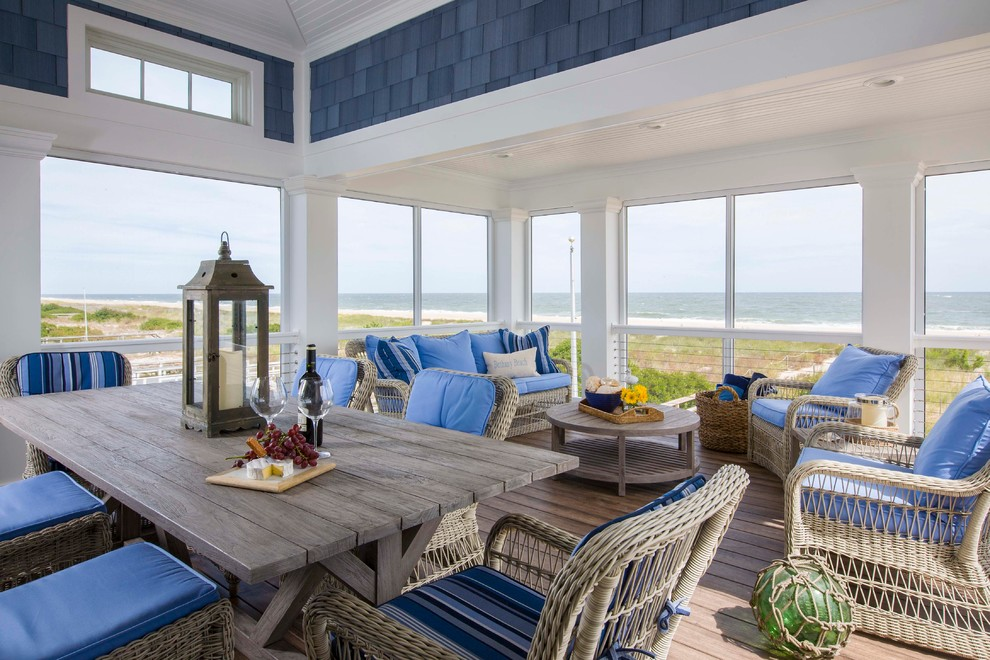 Example of a beach style medium tone wood floor and brown floor sunroom design in Miami with a standard ceiling