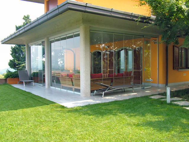 Patio Closed Off With Folding Glass Doors, Water And Airproof  Contemporary Sunroom
