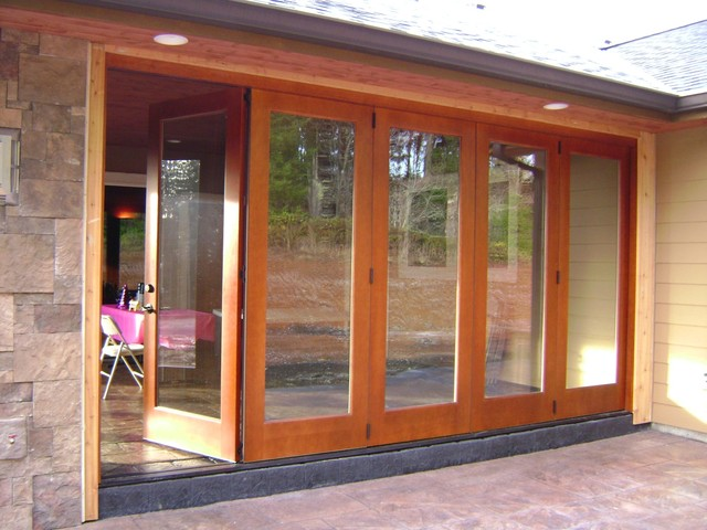 Slide and fold mahogany doors traditional exterior for Exterior folding doors