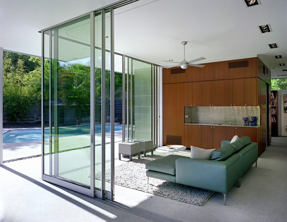 Inspiration for a mid-sized modern concrete floor sunroom remodel in Austin with no fireplace and a standard ceiling
