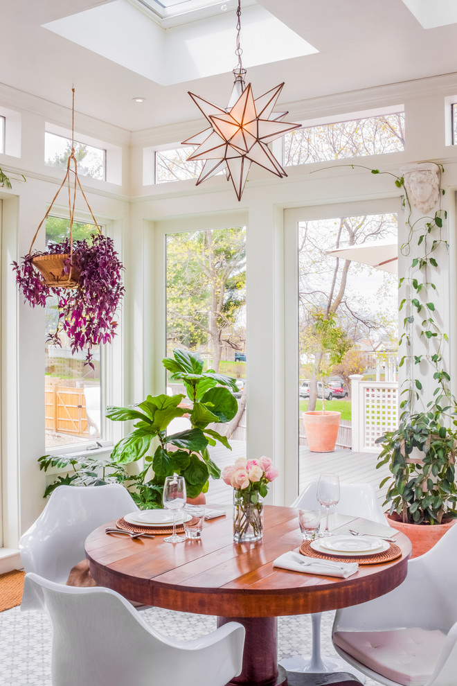 Transitional sunroom photo in Boston with a skylight