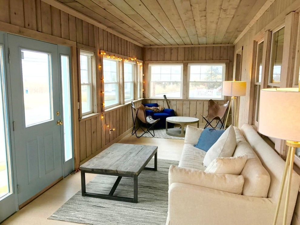 Mid-sized beach style light wood floor and brown floor sunroom photo in New York with no fireplace and a standard ceiling
