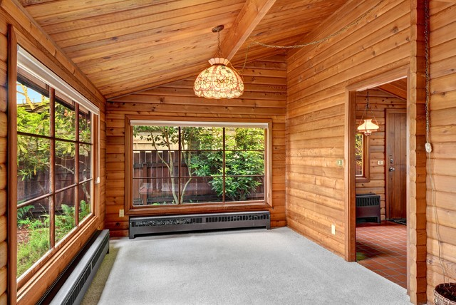 Waterfront Panabode Log Home Rustic Sunroom Seattle