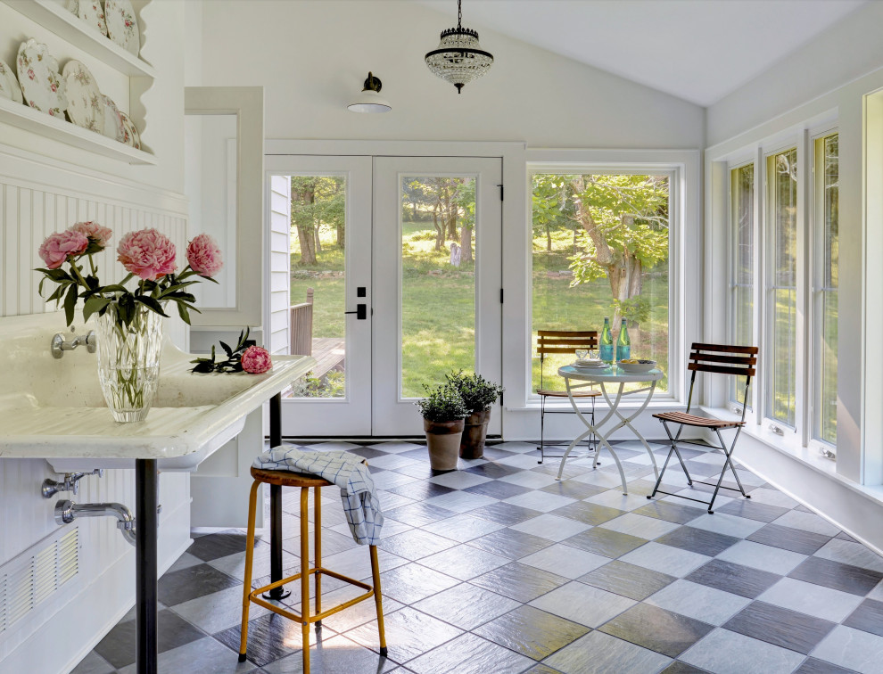 Example of a farmhouse sunroom design in Other