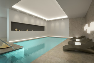 Basement swimming pools with swim currents expand the use of your pool for swimming