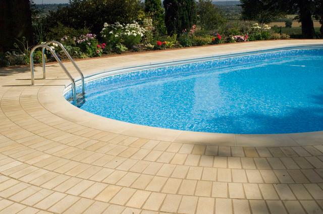 Bespoke natural stone swimming pool edgings for Bespoke swimming pools