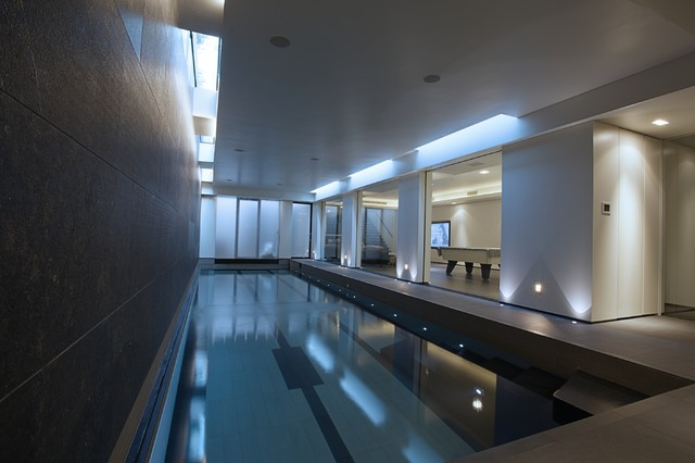 Leisure suite in basement with lutron crestron control Basement swimming pool construction