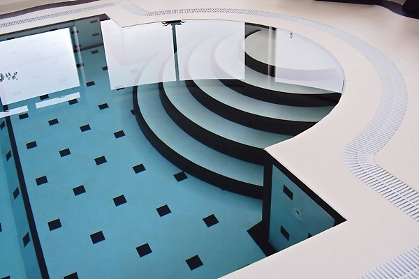 Contemporary Pool Wales Swimming pool wavy tile surround in North Wales contemporary-pool