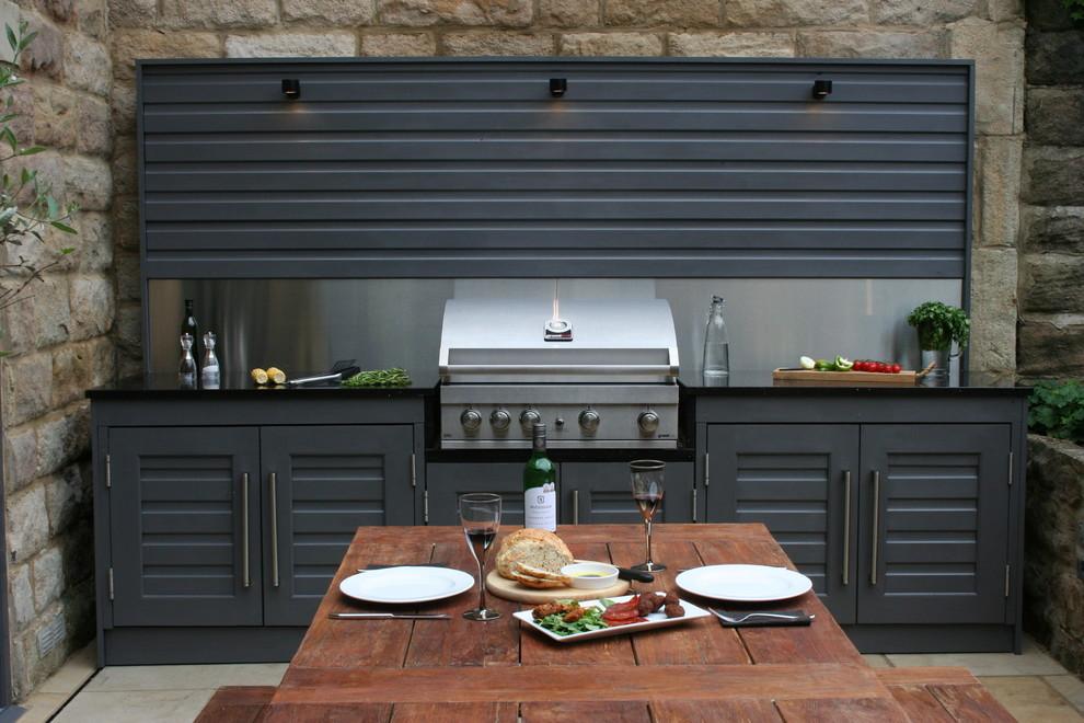 Outdoor kitchen deck - contemporary outdoor kitchen deck idea in Other