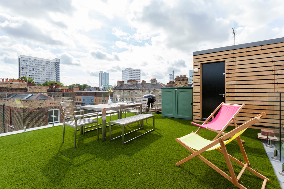Example of a mid-sized trendy rooftop rooftop deck design in London with no cover