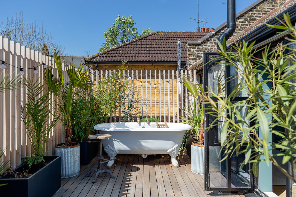 Inspiration for an industrial rooftop deck container garden remodel in London with no cover