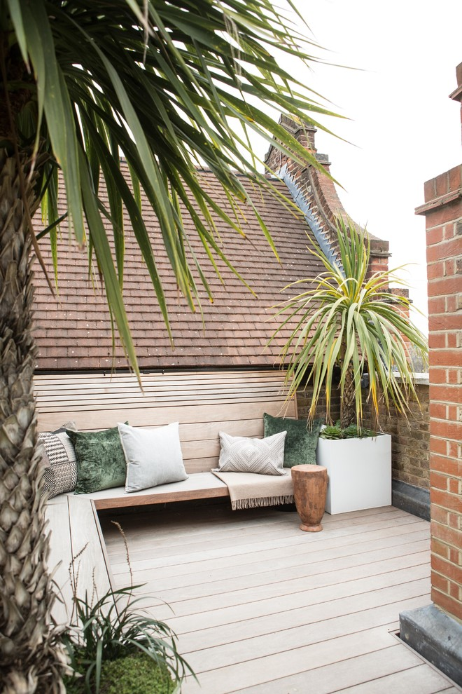 Mid-sized trendy rooftop rooftop deck container garden photo in London with no cover
