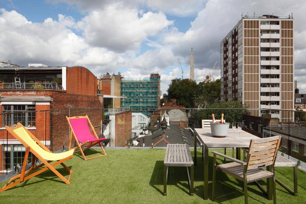 Inspiration for a large contemporary rooftop rooftop deck remodel in London with no cover