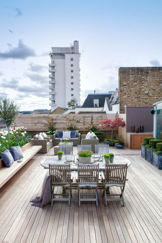Example of a transitional rooftop rooftop deck design in London with no cover