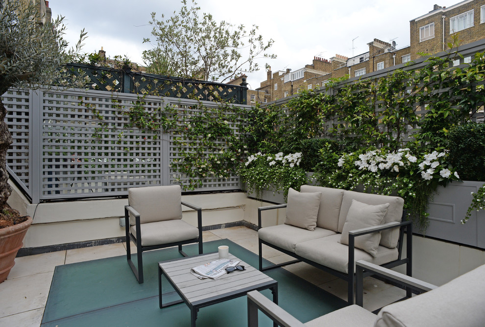 Example of a small classic rooftop deck container garden design in London with no cover
