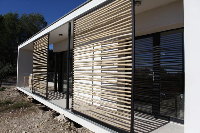 maison individuelle mixte bois b ton contemporain terrasse et patio montpellier par sarl. Black Bedroom Furniture Sets. Home Design Ideas