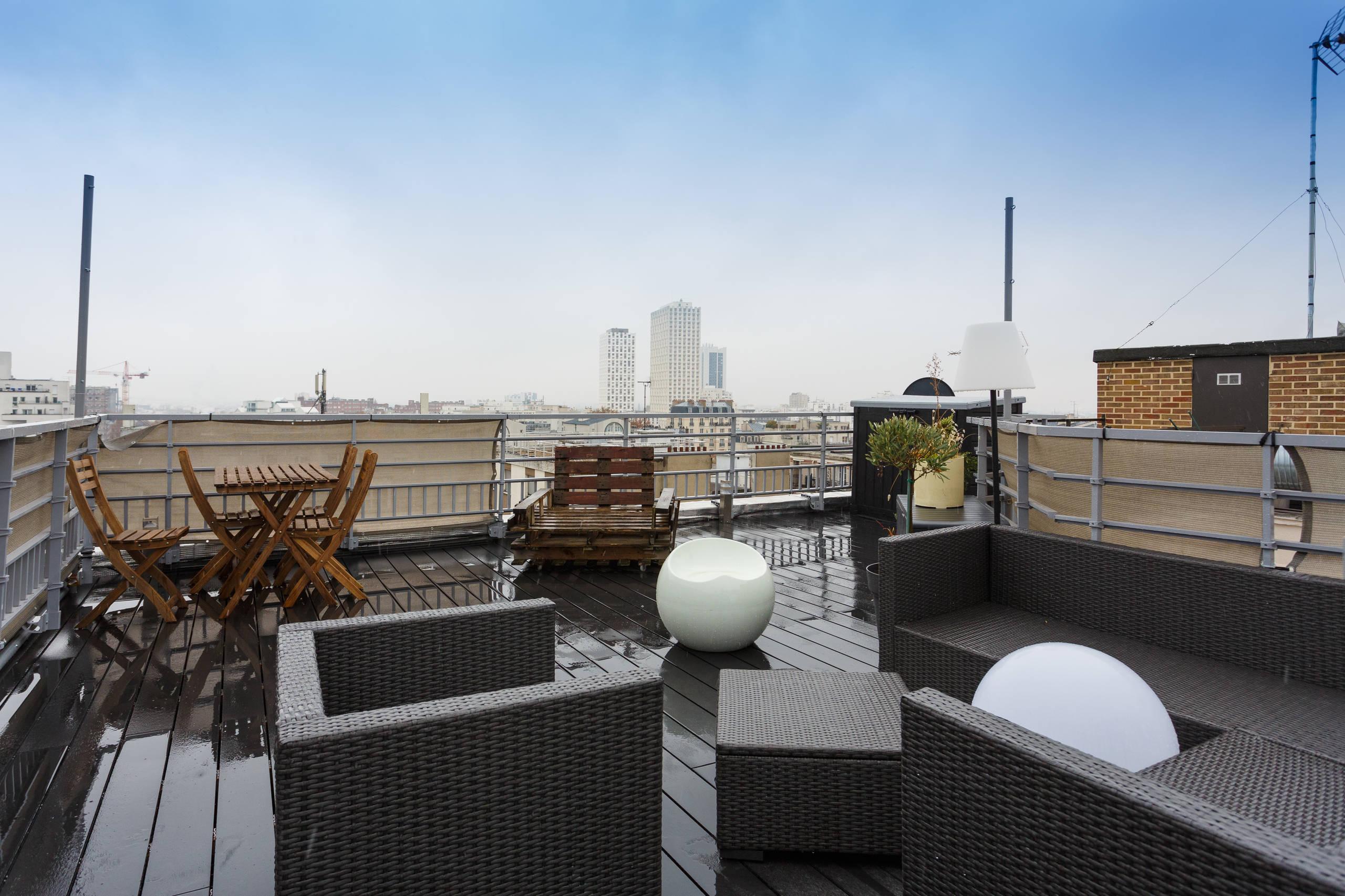 Rooftop avec vue sur les toits de Paris